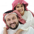 Stock Photo: Adult and child with middle eastern clothes