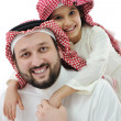 Arabic family, father piggybacking son — Stock Photo