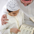 Father teaching little son Koran — Photo