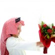 Middle eastern child holding flowers — Stock Photo #11747722