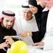 Successful and happy business arabic sitting for a meeting — Stock Photo #11747998