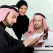 Business arabic meeting indoor with electronic tablet - 
