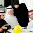 Stock Photo: Portrait of araabic architect explaining his project