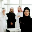 Arabic business woman working in team with her colleagues at office — Stock Photo