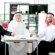 Arabic elderly business with his team at office — Stock Photo