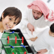 Arabic muslim family playing at home together, father and kids — Stock Photo