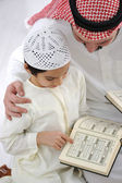 Father teaching little son Koran — Stockfoto