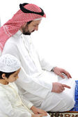 Arabic father and son praying together — Stock Photo
