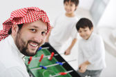 Children playing with father at home, Middle eastern family — Stock Photo