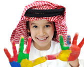 Arabic Muslim child portrait with color on his hands — Stock Photo