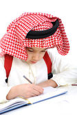 Arabic kid writing — Stock Photo