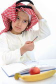 Arabic kid scratching his head gesture for thinking — Stock Photo