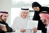 Successful and happy business arabic sitting for a meeting — 图库照片