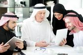 Business arabic meeting indoor with electronic tablet — Stock Photo