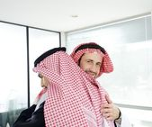 Arabic business embracing each other at meeting for successful deal — Stock Photo
