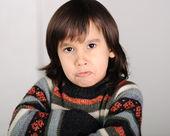 Angry boy with long hair — Zdjęcie stockowe