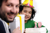 Father giving birthday present to 10 years old daughter — Stock Photo