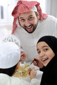 Arabic muslim family eating at home together, father and kids — Stock Photo