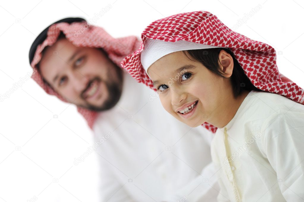 Little boy and his father in traditional middle eastern clothes — Stock Photo #11747379