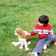 Young  boy playing with a dog — Stock Photo