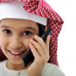 Foto Stock: Portrait of arabikid speaking on phone