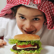 Arabic kid with burger — Stock Photo #11751103