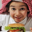 Arabic kid with burger — Stock Photo #11751106