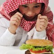 Middle Eastern little boy with hamburger — Stock Photo #11751117