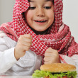 Middle Eastern little boy with hamburger — Stock Photo #11751123