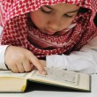 Muslim boy reading Koran — Stock Photo