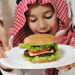 Cute kid with cheeseburger — Stock Photo #11751145