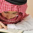 Muslim boy reading Koran — Foto de Stock
