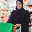 Image of pretty muslim woman with cart — Foto Stock