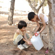 Helping in washing hands with water in nature, children summer camp — Stock Photo #11751308