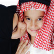 Arabic Muslim mother kissing her little son — Stock Photo