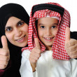 Arabic Muslim mother and son with thumb up — Stock Photo