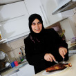 Beautiful muslim woman in the kitchen — Stock Photo