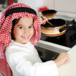 Little kid boy is cooking — Stock Photo