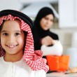 Muslim mother and little son in the kitchen — Stock Photo