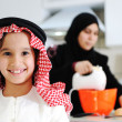 Stock Photo: Muslim mother and little son in the kitchen