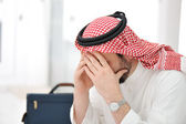 Sad middle eastern business man — Stock Photo