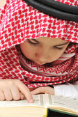 Muslim child with Koran — Stockfoto