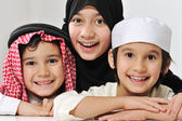 Little Muslim Arabic girl and two boys portrait — Stock Photo