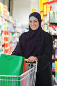 Image of pretty muslim woman with cart — Stock Photo
