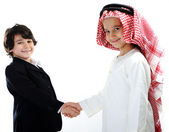 Middle eastern and european children businessmen teamwork — Stock Photo