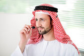 Portrait of a smart arabic business man using headset. Call cen — Stock Photo