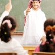 Arabic Muslim teacher in classroom with children. Competition an — Stock Photo