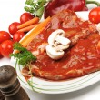 Prepating sliced meat with sauce on board with vegetables — Stock Photo #12095991
