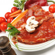 Prepating sliced meat with sauce on board with vegetables — Stock Photo