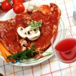 Stock Photo: Prepating sliced meat with sauce on board with vegetables